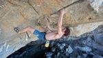 Adam Ondra climbing towards the world's first 9c