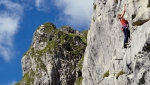 Avostanis, rock climbing above an enchanting lake in Italy Carnic Alps